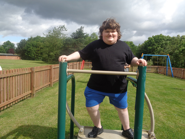 Daniel on the outdoor gym equipment